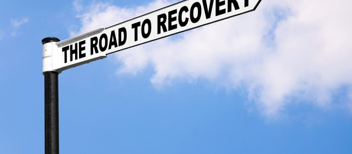 Concept signpost image for the saying The road to recovery. Good image for healthcare or financial related themes.